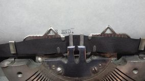 Typing text at the typewrite. Typing THE END at the typewriter stock video