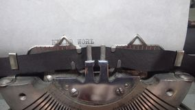 Typing text at the typewrite. Typing Hello World at the typewriter stock video footage