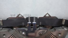 Typing text at the typewrite. Typing You Are Fired at the typewriter stock video