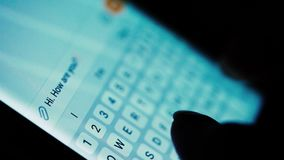 Typing texting message on a smartphone in portrait mode. White, backlit, background stock footage