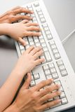 Typing together Stock Photos