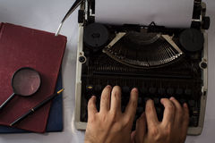 Typing with typewriter,top view. Royalty Free Stock Photography