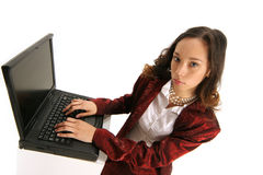 Typing up your deal. Professional businesswoman has success with your transaction Royalty Free Stock Photos