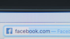 Typing the URL site - facebook - close up stock video
