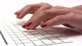 Typing on a White Computer Laptop Royalty Free Stock Photography