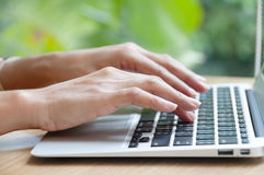 Typing. Woman working hard on laptop Stock Photography