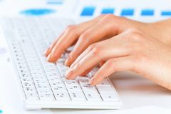 Typing work. Close up of female hands typing on keyboard stock photos