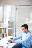Typing at workplace Royalty Free Stock Photo