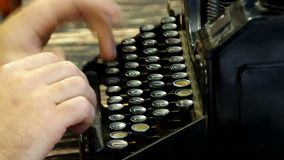 Typing on writing machine. Hands typing on old writing machine. Fingers and vintage typewriter on desk. Loopable and seamless footage stock video footage