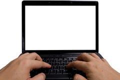 Typiong em um computador portátil pessoal fotografia de stock