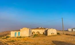 Typisch berberhuis in het Tunesische platteland in Tataouine stock fotografie