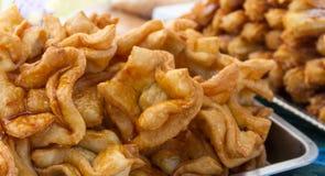 Typische Argentijnse zoete die gebakjes in olie worden gebraden stock afbeeldingen