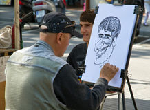 Typische caricaturist Stock Afbeelding