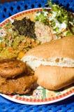 Typische tinidad Nahrungsmittelmehrlagenplatte Stockfoto