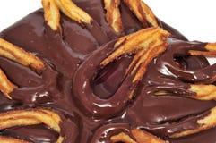 Typischer spanischer süßer Imbiß der Churros Betrug-Schokolade Stockbild