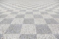 Typischer Steinboden von Lissabon Lizenzfreie Stockfotos