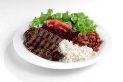 Typischer Teller von Brasilien, von Reis und von Bohnen Lizenzfreie Stockfotografie