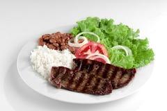 Typischer Teller von Brasilien, von Reis und von Bohnen Stockfoto
