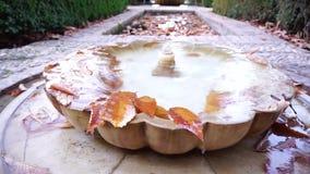 Typischer Wasserbrunnen auf dem Boden in Granada stock video footage