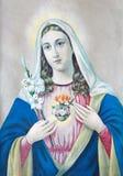 Typisches katholisches Bild des Herzens von Jungfrau Maria von Slowakei druckte in Deutschland vom Beginn von 20 cent stockbild