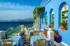 Typisk färgrik grekisk restaurang, Kalymnos, Dodecanese öar, Royaltyfria Foton