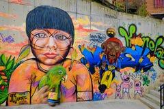 Typiska grafitti i Comuna 13, Medellin Arkivbilder
