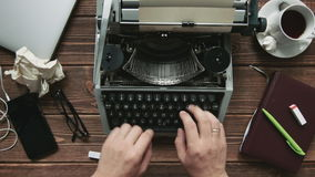 Typist at his workplace. Cropped shot of man working on old-fashioned typewriter at his workplace stock video