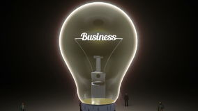 Typo 'Business' in light bulb and surrounded businessmen, engineers, idea concept version (included alpha). Typo in light bulb and surrounded stock video