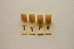 Typo - woord in kleverige brieven stock foto's