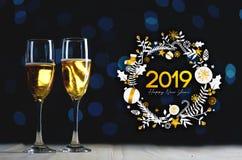 Typografikonst 2019 Två exponeringsglas av Champagne Dark Glow Lights B royaltyfria bilder