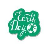 Typografisches Designplakat für Tag der Erde mit Weltkarte Lizenzfreie Stockfotos