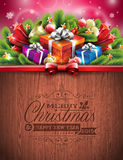 Typografisk design för inristad glad jul och för lyckligt nytt år med feriebeståndsdelar på wood texturbakgrund Arkivfoton