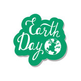 Typographic design poster for Earth Day with world map. Royalty Free Stock Photos