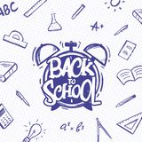 Typographic lettering of Back to School with alarm clock and doodles supplies on sheet of exercise book background stock illustration