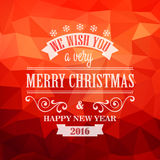 Typographic Retro Christmas Design. On the red polygonal background Royalty Free Stock Photography