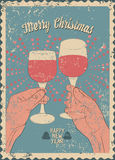 Typographic vintage style Christmas card or poster design with clink glasses.  Royalty Free Stock Photography
