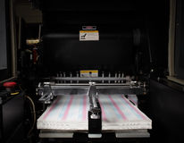 Typographical printing machine with paper in tray Royalty Free Stock Images