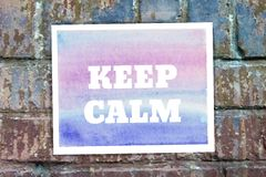 Typographical Watercolor Poster on a Brick Wall Royalty Free Stock Photography