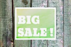 Typographical Watercolor Poster on a Green Wooden Stock Photo