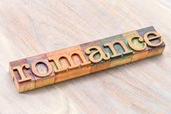Typographie Romance de mot dans le type en bois Photo stock