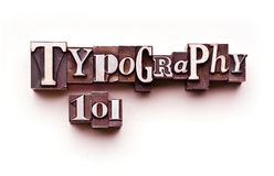 Typography 101. The words Typography 101 done in letterpress type on a white paper background Royalty Free Stock Photos