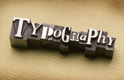 Typography. The word Typography done in letterpress type on a linen paper background royalty free stock image