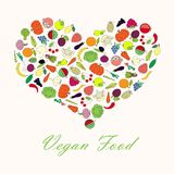 Typography banner Vegan Food. Shape heart from line colorful fruit and vegetables Royalty Free Stock Photos