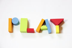 Typography colorful play. The word play built from colorful toy bricks stock image