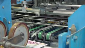 Printing press printed brochure stock video footage