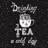 Typography poster with cup. Hand drawn typography poster with cup, snow and snowflakes. Conceptual handwritten phrase Drinking hot tea on a cold day. T shirt Royalty Free Stock Photo