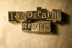 Typography review - Metal letterpress lettering sign. Lead metal  typography text on wooden background Royalty Free Stock Photos