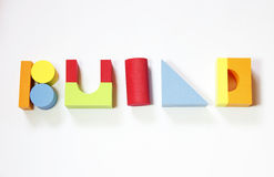 Typography from toy bricks. Colorful toy bricks compose the word build. Encourage to be playful creative and productive royalty free stock image