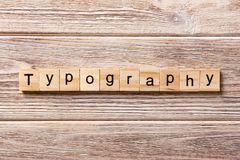 Typography word written on wood block. typography text on table, concept.  Royalty Free Stock Photo