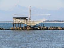 Typical italian fishing net along the river Arno in Marina di Pisa, Tuscany, Italy Royalty Free Stock Images
